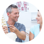 Chiropractor Assessing A Spine With A Patient